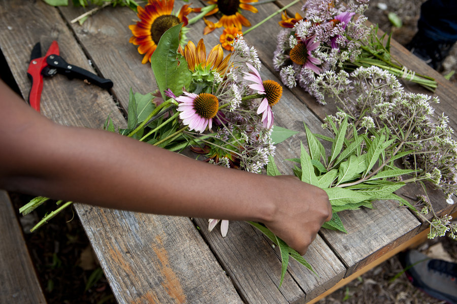 Students at Eastern Senior High School in Washington, D.C., trim bouquets to sell at the farmers market. Lydia Thompson/NPR