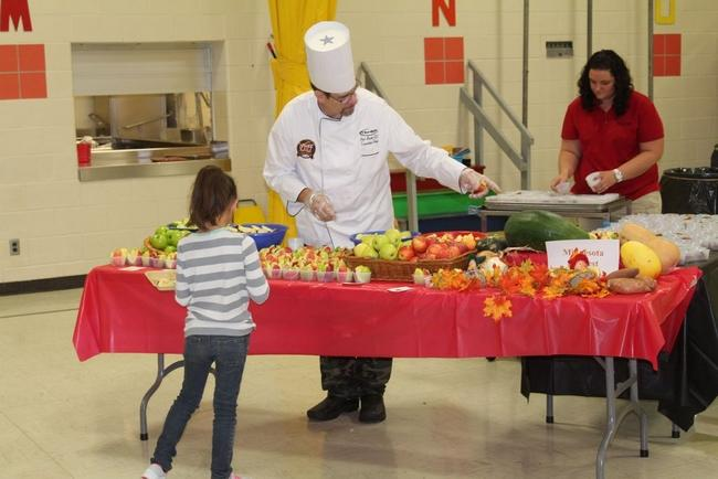 Chef Paul Booth, from Taher Food Services, and Abby Grove, food services coordinator for the school district, served up four different varieties of apples, as well as sweet potato harvest bars, at Northside Elementary School.