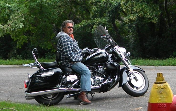 Chris Murray on his Harley